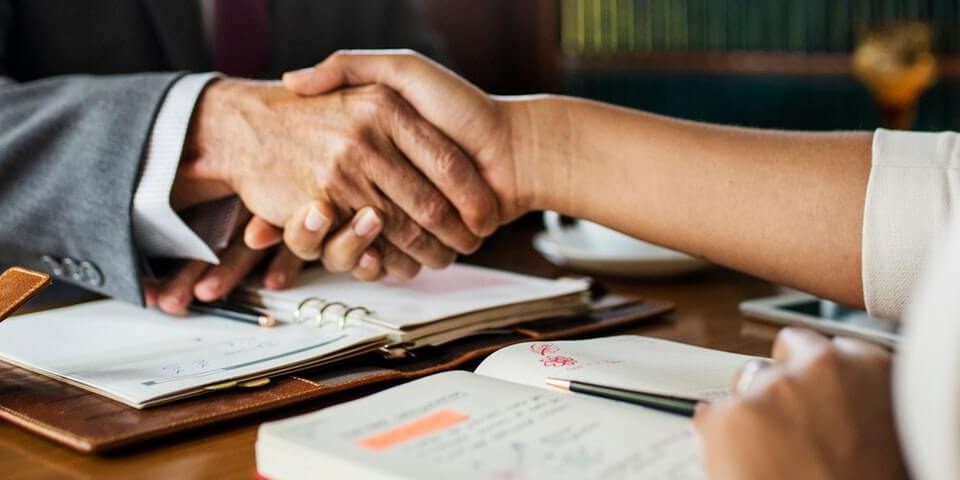 Handshake with Visa Consultant